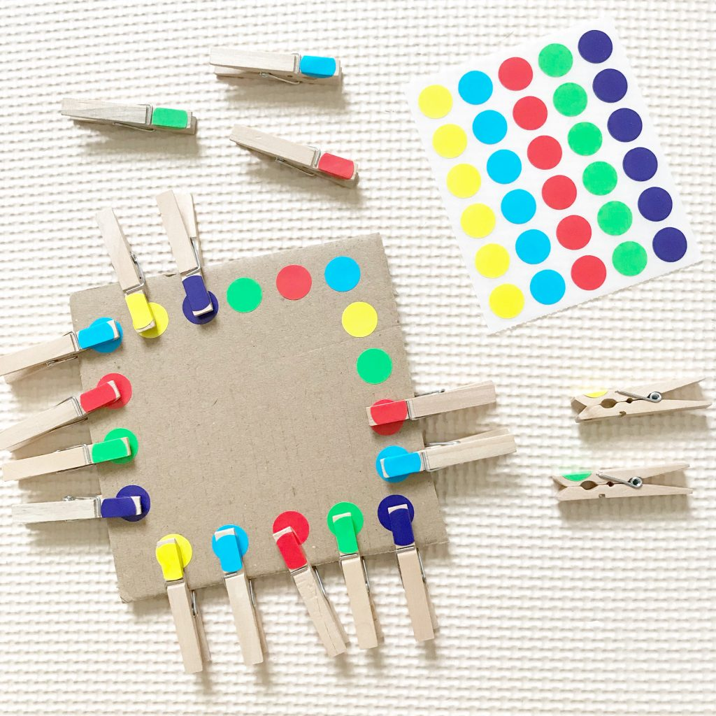 art supplies - dot stickers and cardboard